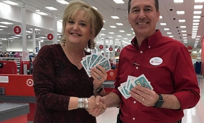 MCCC's Jane Nauman shaking hands with Steve Rice at Target