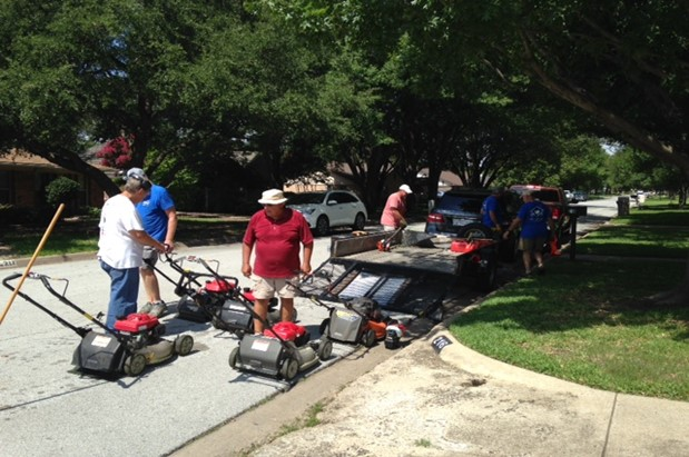 Group of people with mowers